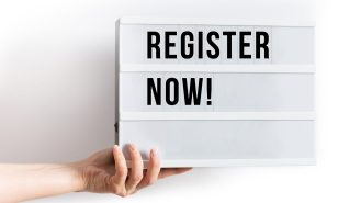 Register Now [A lightbox with the words 'register now' on.  The lightbox is held by a hand on the left hand side]
