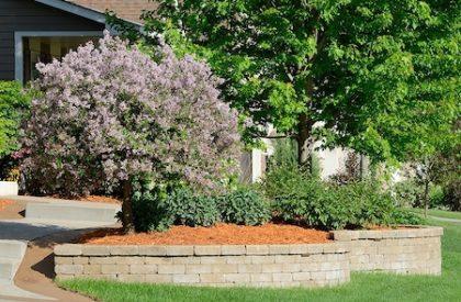 landscaping designer installs retaining walls