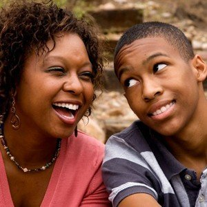 emotionally healthy mom laughing with annoyed teen son | parent coaching helps moms learn therapeutic parenting, healthy relationship skills, and peaceful connection.