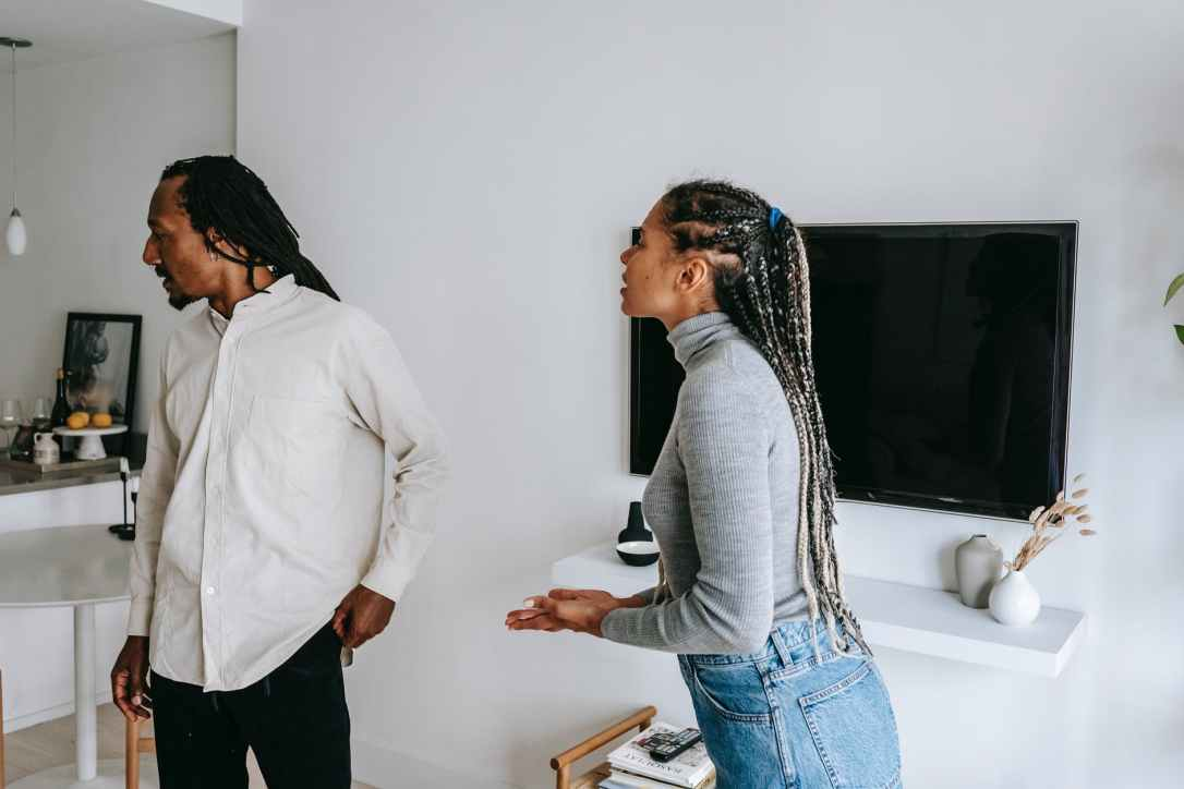 expressive african american couple quarreling in room