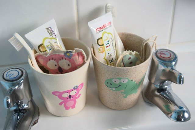 Jack N' Jill tooth paste and toothbrushes in rinse cups