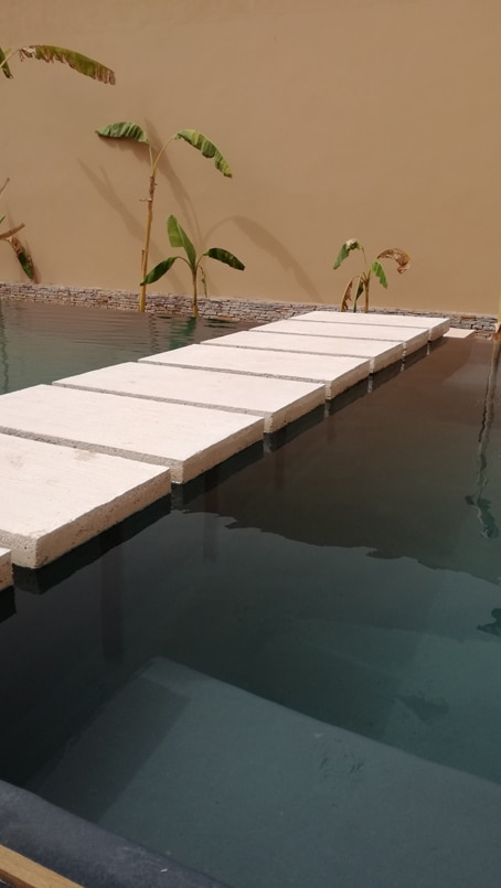Japanese steps floating over water in an overflow pool
