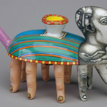 """""""The Delivery,"""" 1996, porcelain, glaze, stain, 5.5 x 11 x 4"""". Collection of Racine Art Museum, Racine, WI."""
