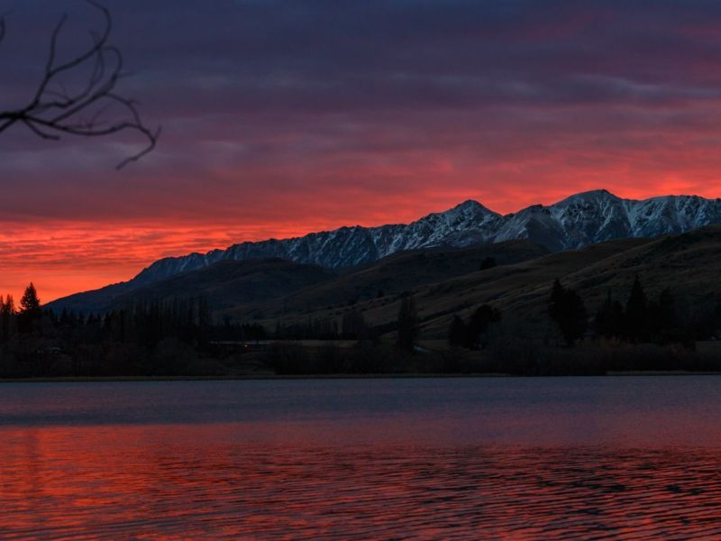 lake mountains sunset orange red reflection