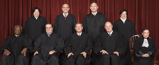 The justices of the U.S. Supreme Court tried to go in together on a pizza, but are deadlocked and waiting for Justice Kennedy to choose between Meatlover's and Plain Cheese.