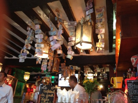 The bar, with mobiles made of various currency.