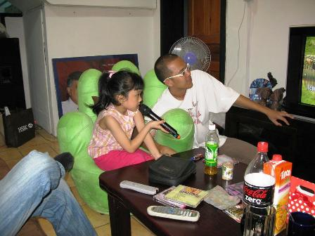 Mr. Yap, my great helper in class, guiding his daughter on karaoke session
