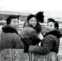 ON A SLEIGH, the three Kim sisters start off for a horse-drawn tour of the snow-covered farm. From the left are Sook Ja, Ai Ja and Min Ja.