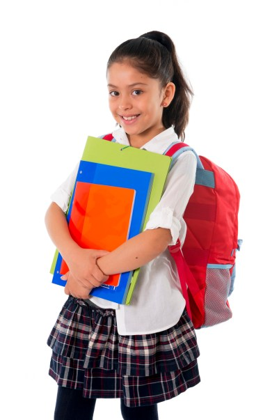 happy sweet little school girl carrying schoolbag backpack and books smiling in education and back to school concept isolated on white background