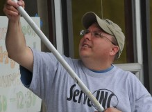ServeINC Volunteer painting at Lafayette