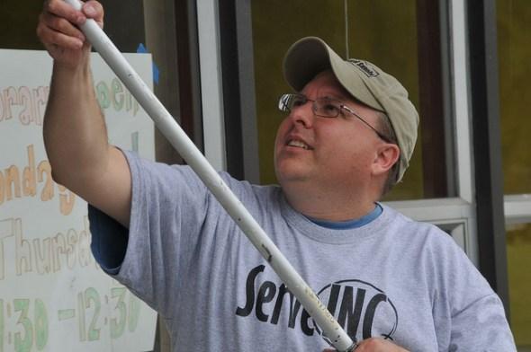 ServeINC Volunteer painting at Lafayette