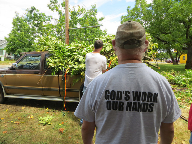 """Transformations   A volunteers t-shirt read, """"God Work, Our Hands."""""""