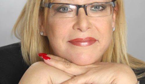 irene becker canada leadership expert color headshot hands together under face smiling