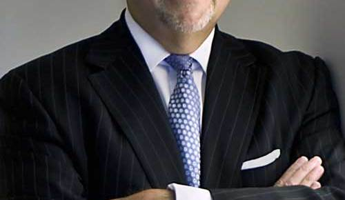 peter kalis lawyer color smiling arms crossed suit and tie