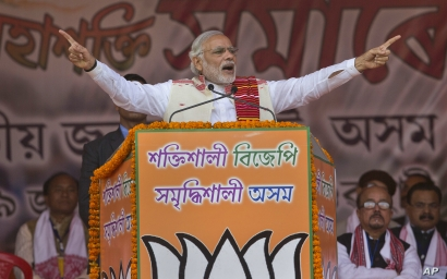 Indian Prime Minister Narendra Modi addresses a youth rally organized by the Bharatiya Janata party (BJP) ahead of Assam state elections in Gauhati, India, Jan. 19, 2016.