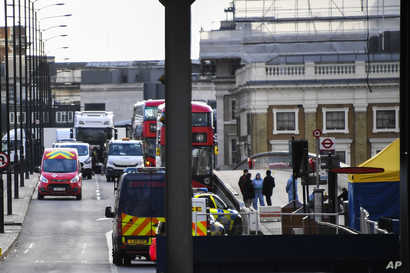 Cars and buses are seen stationary on London Bridge in London, Sunday, Dec. 1, 2019, as police forensic work is completed…