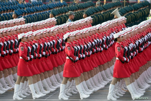 Militia members and soldiers of People's Liberation Army (PLA) march past Tiananmen Square during a rehearsal before a military parade marking the 70th founding anniversary of People's Republic of China, on its National Day in Beijing.