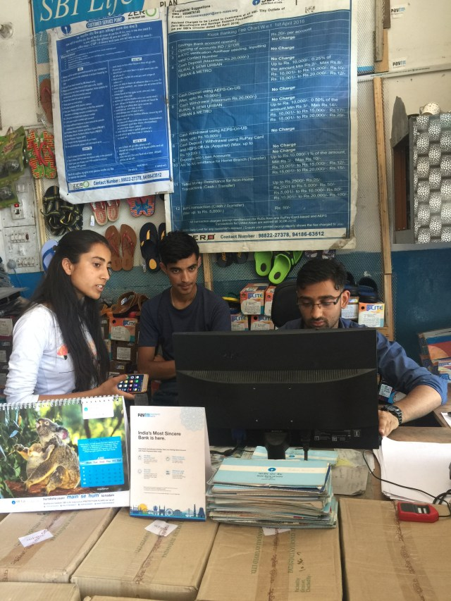 Customers use their phones to make digital payments at the local shop. (A. Pasricha/VOA)