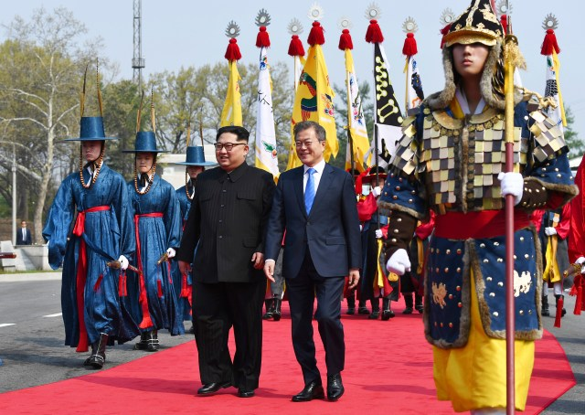 North Korean leader Kim Jong Un, left, and South Korean President Moon Jae-in walk together at the border village of Panmunjom in the Demilitarized Zone, April 27, 2018.