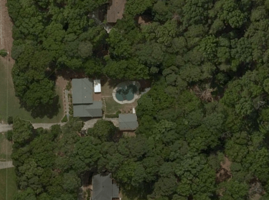 Satellite view of my property showing the main house, pool, and detached garage / apartment.