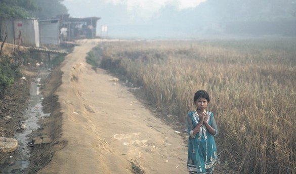 A Rohingya migrant child walks through the Balukhali refugee camp in Cox's Bazar, Bangladesh, Nov. 28.