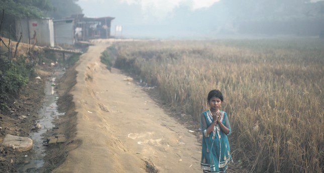 A Rohingya migrant child walks through the Balukhali refugee camp in Cox's Bazar, Bangladesh, Nov. 28.