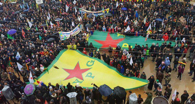 YPG supporters wave giant flags during a protest against Turkey's counterterrorism operation into Afrin to eliminate YPG terrorist elements near its borders to protect the safety of both its own people and Syrians, Syria, Jan. 18.
