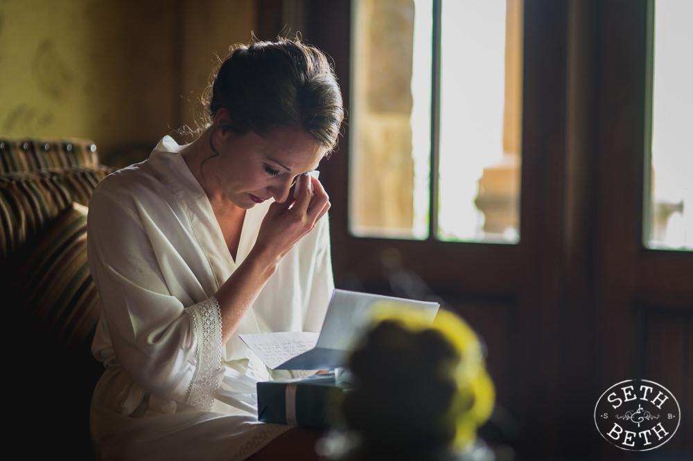 A bride reading a letter at a Gervasi Vineyard Wedding