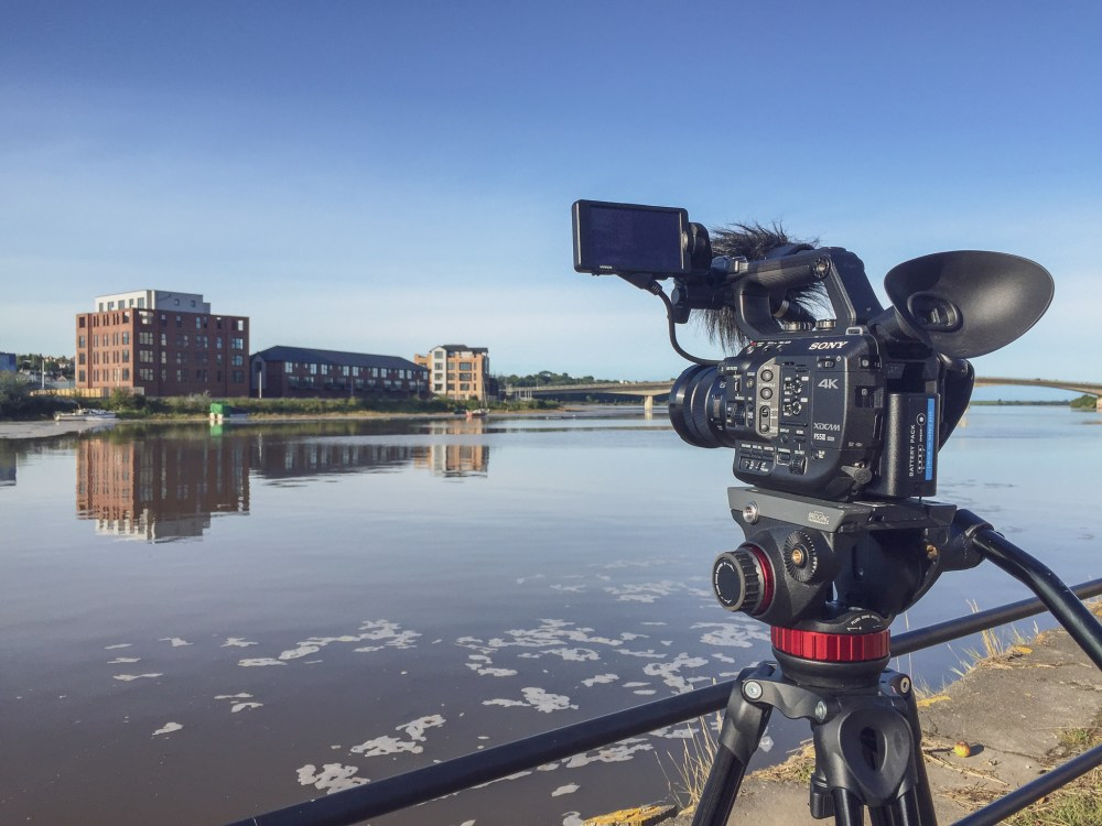 The Taw Wharf housing development filmed from across the River Taw at high tide