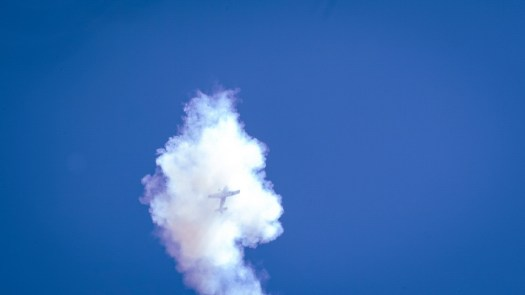 Plane in the sky with a smoke trail