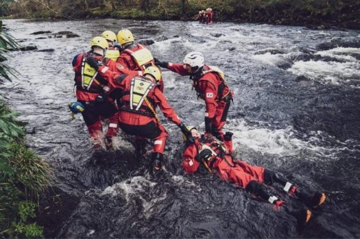 Trainees pulling a 'victim' out of a river