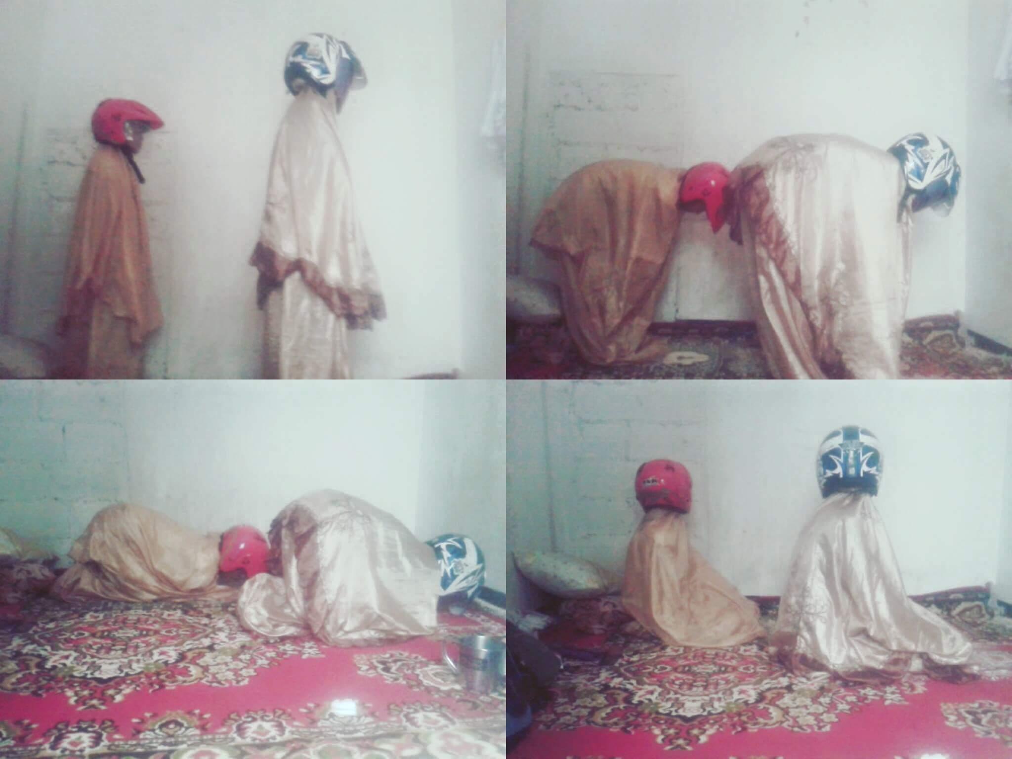 Alayer wanita Sholat dengan memakai helm