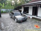 Mobil sedan pasang roofbox dan roofrack