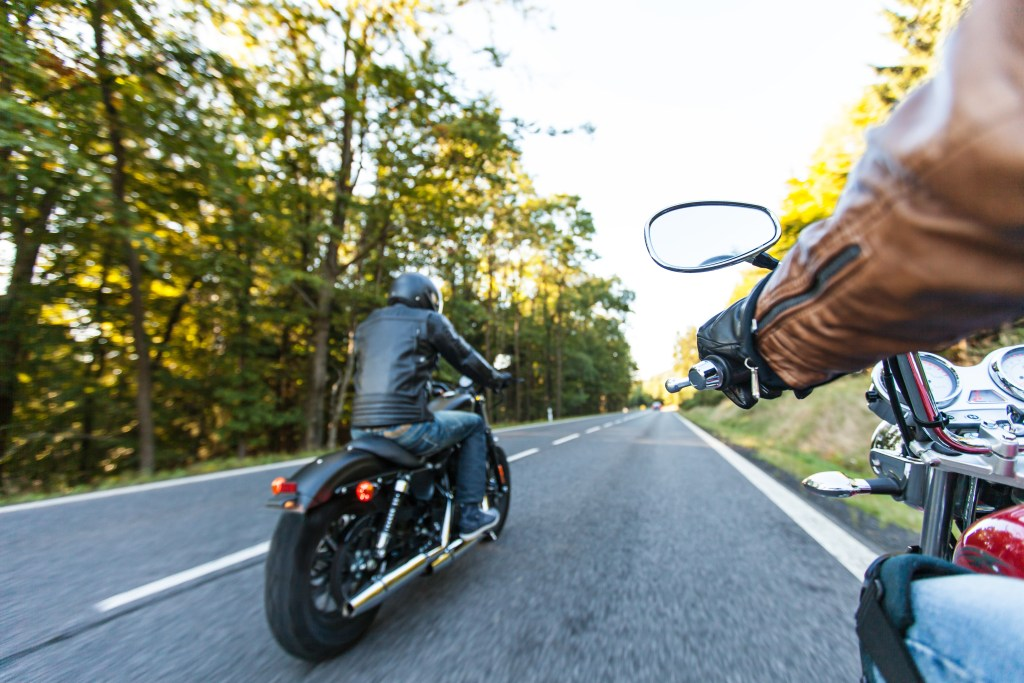 men-riding motorcycles-on-highway