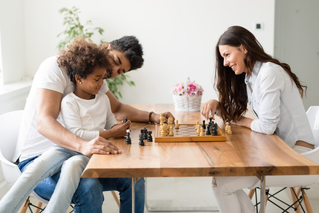 family-playing-chess
