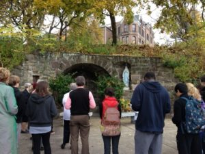 Commemorate: Members of the SHU community reflect before Our Lady's Grotto to celebrate its 100th anniversary.