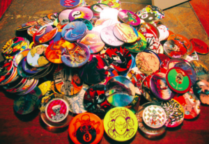 Pogs bring back feelings of joy and hostility. Photo courtesy of fy90s.tumblr.com