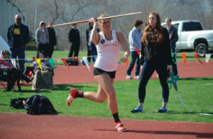 Mallory Sanner with the running start as she gets ready to launch the javelin to the air. Photo courtesy of D.Clark/Setonian