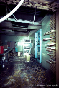 Medical supplies and materials are scattered throughout the hospital's morgue. Photo courtesy of Sherman Cahal Works