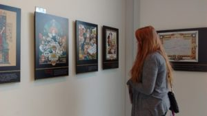 "Freshman Emalee Cantalin explores ""Justice Illuminated: The Art of Arthur Syzk"" in the Harlan Gallery at the Seton Hill Arts Center. Photo courtesy of H.Carnahan/Setonian"