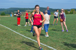 Meagen Carter, a senior runner from Glenshaw, Pa., sprints toward the finish line. Photo courtesy of D.Clark/Setonian