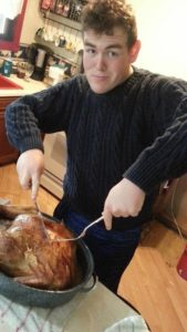 Chuck carves the turkey. Photo courtesy of C.Horsley/Setonian.