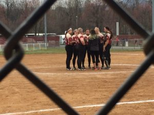 The Lady Griffins huddle around the pitchers circle discussing the game plan and giving each other confidence. Photo courtesy of J. Palmer