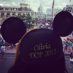 Gazing at Cinderella's castle in Disney's Magic Kingdom, junior Olivia Schultz sports her Disney College Program graduation ears. Photo courtesy of  O.Schultz.