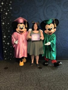 Mickey and Minnie Mouse pose for a picture with Schultz after her 2015 graduation from the program. Photo courtesy of O.Schultz.