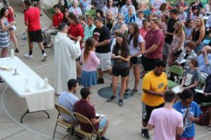 Students and faculty gather for Mass on the Grass. Photo courtesy of E.Michaux.