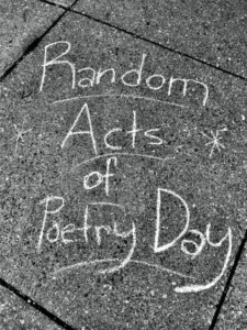 Colorful chalk poetry and artworks crowded the sidewalk outside Reeves Library. Photo courtesy of E.Vissat.