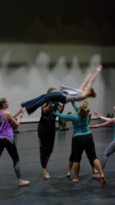 Dancers practice a move from student choreographer Chelsea Pawlak's piece. Photo courtesy of B.Malley.