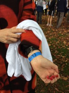 President Mary Finger shows off her wristband, sporting the last number in the line. Photo courtesy of H.Carnahan/Setonian.