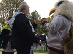 The first fist bump was shared between the Griffin and Sister Maureen O'Brien, director of campus ministry. Photo courtesy of H.Carnahan/Setonian.